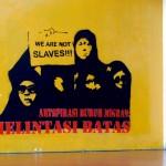 solidaritas buruh migran, stencil art on wall